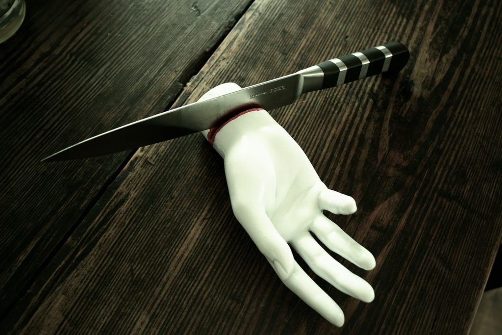 Slit - hand shaped knife sharpener